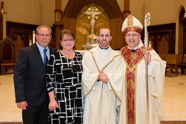 Father Adam Maher with parents and Bishop