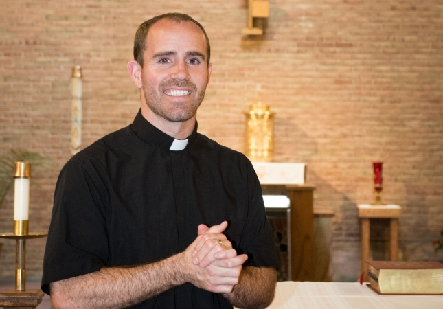 Father Adam Maher poses for a portrait in Our Lady Consolata Parish, Cass City.