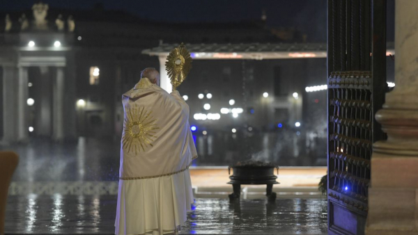 Pope Francis blesses the City of Rome and the World, holding the monstrance on the steps of St. Peter's Basilica in Rome.